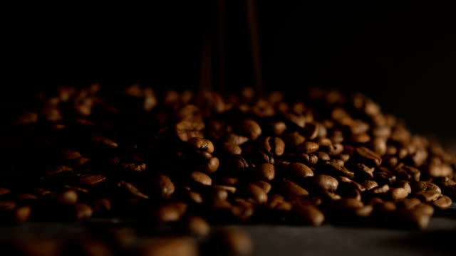 coffee beans on black table - caffeine molecule stock videos & royalty-free footage