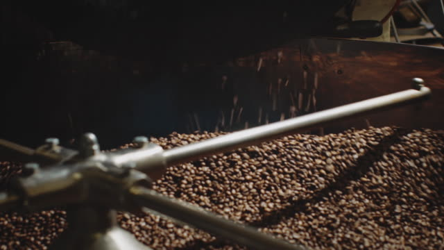 coffee beans roasting in machine at factory - roasted stock videos & royalty-free footage