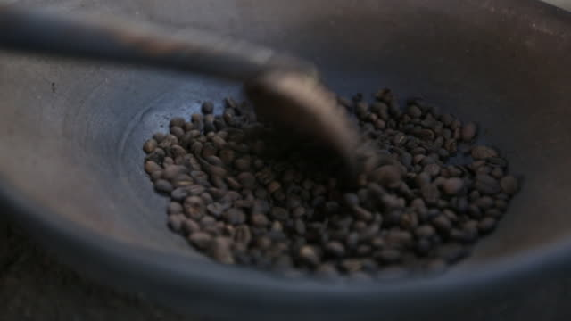 cu coffee beans roasting on open fire - preparation stock videos & royalty-free footage