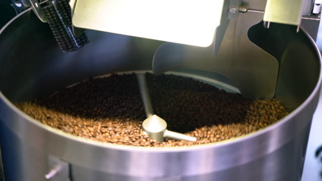 coffee beans spinning in a cooling drum - roasted stock videos & royalty-free footage