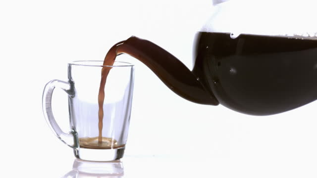 MS SLO MO Coffee being poured in Cup / Vieux Pont, Normandy, France