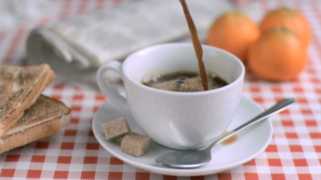 coffee being poured in super slow motion - saucer stock videos & royalty-free footage