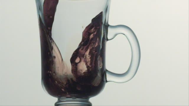 CU SLO MO Coffee being poured into mug / San Francisco, California, USA