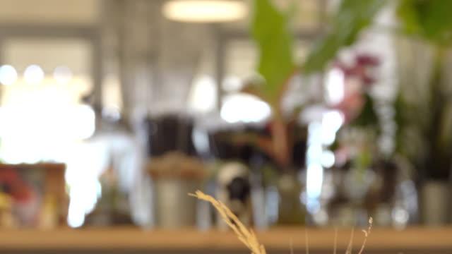 4k: coffee cafe scene, blur shot - coffee shop background stock videos & royalty-free footage