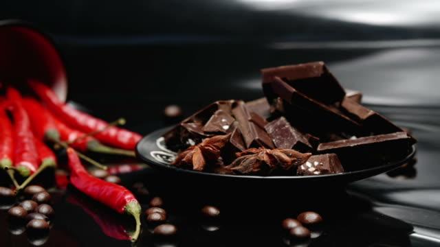 coffee, chocolate and chili over black - peperoncino video stock e b–roll