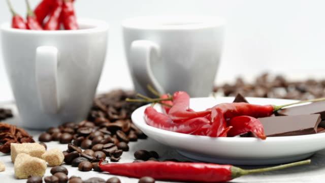 kaffee, schokolade und chili über weiß - chili schote stock-videos und b-roll-filmmaterial
