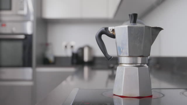 coffee coming to the boil - kitchen worktop stock videos & royalty-free footage