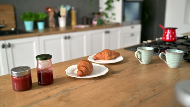 coffee, croissants and jam on kitchen counter for breakfast - french food stock videos & royalty-free footage