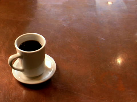 coffee cup and saucer on copper counter - saucer stock videos and b-roll footage