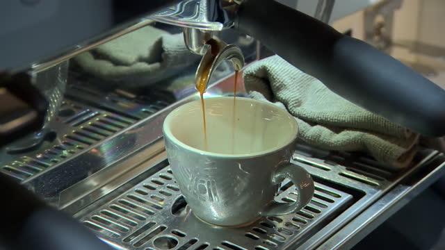a coffee cup being filled by a cappuccino machine - belfast stock videos & royalty-free footage
