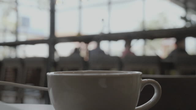 slo mo: coffee cup during coffee break. - coffee table stock videos & royalty-free footage