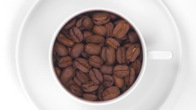 hd coffee cup filled with roasted beans - drehen stock videos & royalty-free footage