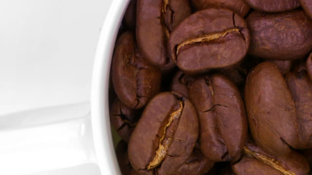 cu coffee cup filled with roasted beans - drehen stock videos & royalty-free footage