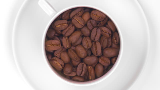 coffee cup filled with roasted beans - drehen stock videos & royalty-free footage