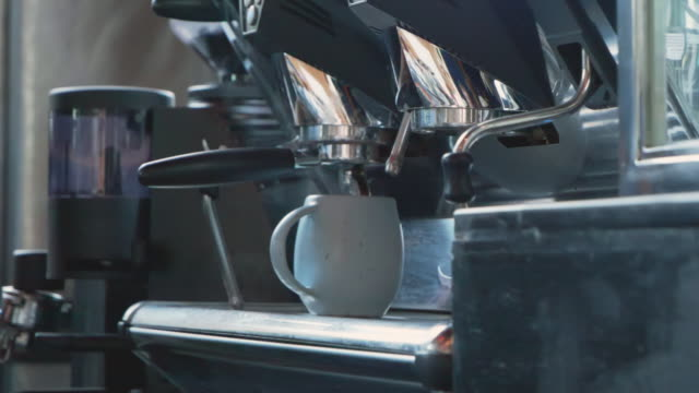 slo mo; coffee cup on coffee machine. - breakfast room stock videos & royalty-free footage