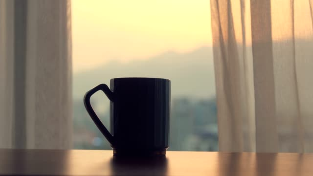 coffee cup on table in the morning - cup stock videos & royalty-free footage