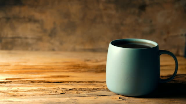 coffee cup on wood table - tea cup stock videos & royalty-free footage