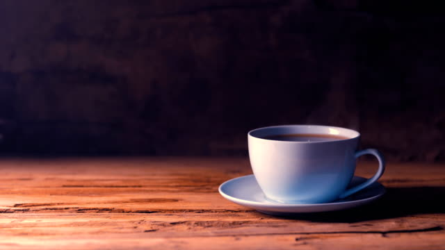 coffee cup on wood table - coffee cup stock videos & royalty-free footage