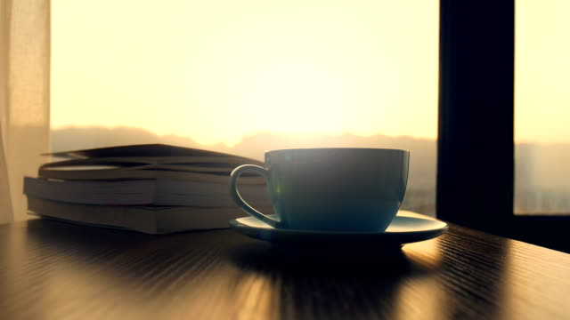 coffee cup with book on table - coffee cup stock videos & royalty-free footage