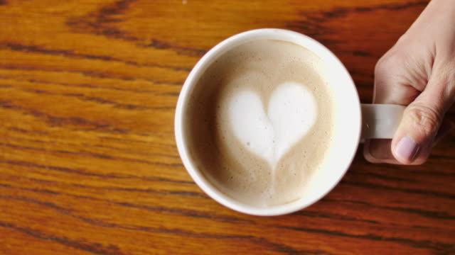 coffee cup with latte art heart - coffee cup stock videos & royalty-free footage