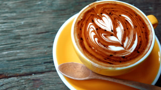 coffee cup with latte art heart - latte stock videos and b-roll footage