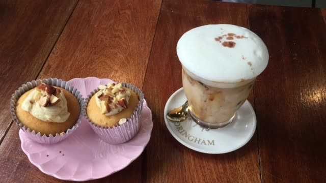 coffee cup with muffin on cafe shop table - blueberry muffin stock videos & royalty-free footage