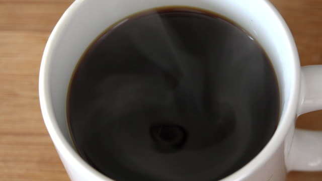 coffee drink: hot black coffee drink with vapor - coffee drink stock videos & royalty-free footage