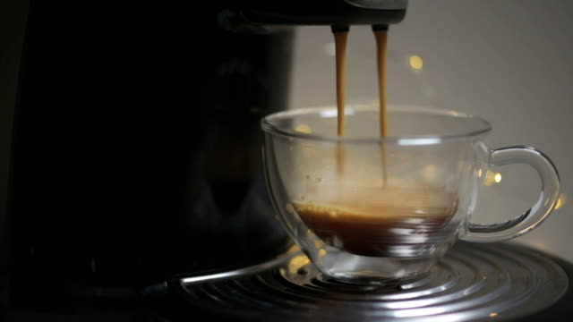 coffee dripping from machine into cup - espresso stock videos & royalty-free footage