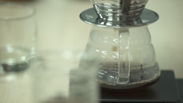 coffee dripping from the coffee strainer - caffeine stock videos & royalty-free footage