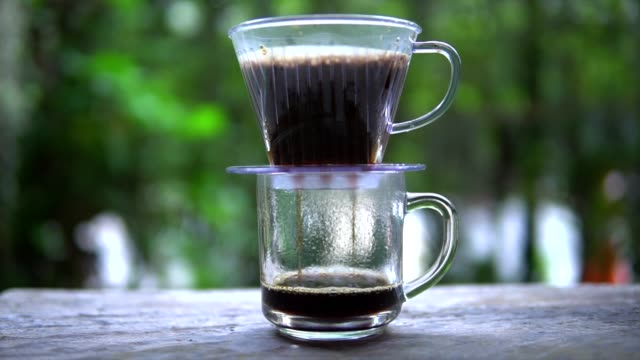 coffee drop in to cup of coffee - coffee table stock videos & royalty-free footage