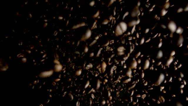 coffee food explosion with coffee beans - roasted coffee bean stock videos & royalty-free footage