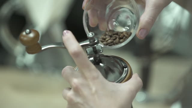 coffee grinder in slow motion - coffee drink stock videos & royalty-free footage