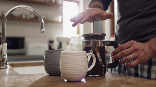 coffee is always a must - home interior stock videos & royalty-free footage