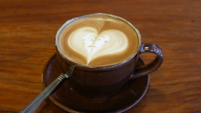 coffee latte art at coffee shop , 4k resolution , uhd - coffee cup stock videos & royalty-free footage
