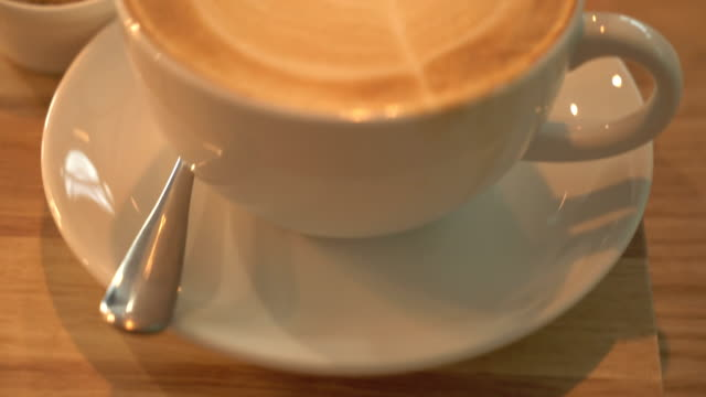 coffee latte art at coffee shop - latte stock videos and b-roll footage