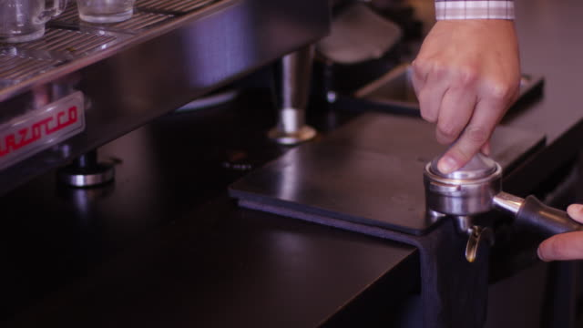 slow motion: coffee machine being used inside coffee shop - fatcamera stock videos & royalty-free footage