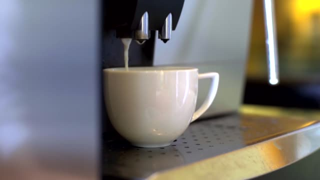 coffee machine brewing hot fresh coffee. - automatic stock videos & royalty-free footage