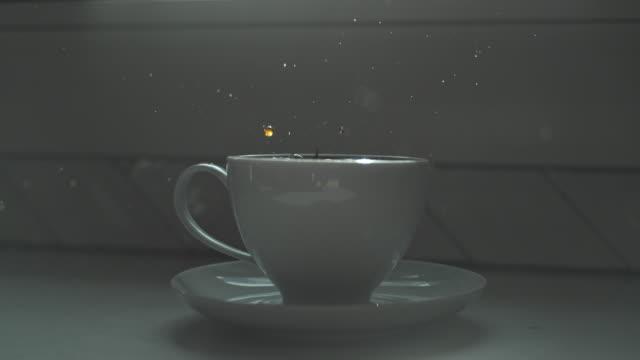 coffee macro slow motion splash cup morning - jug stock videos & royalty-free footage