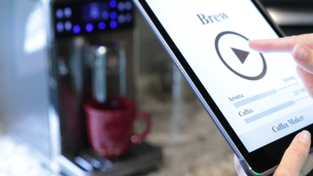 Coffee Maker Inside Smart Home Being Controlled on Digital Tablet