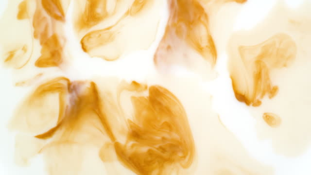 coffee mixing with milk. slow motion - cream stock videos and b-roll footage