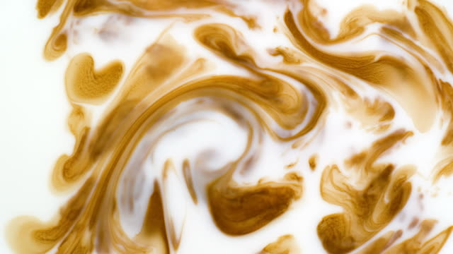 coffee mixing with milk. slow motion - milk texture stock videos & royalty-free footage
