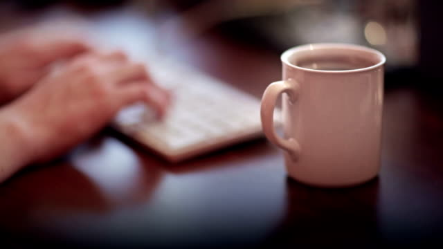 coffee mug on the wooden desk - coffee drink stock videos & royalty-free footage