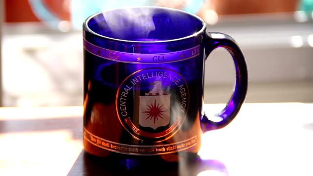 cia coffee mug with steam - マグカップ点の映像素材/bロール