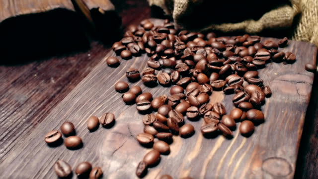 coffee on brown wood - sacca video stock e b–roll