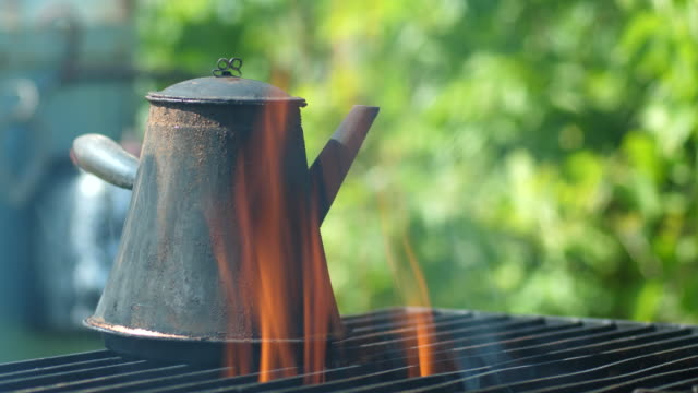 coffee pot cooking over open fire - boiling stock videos & royalty-free footage