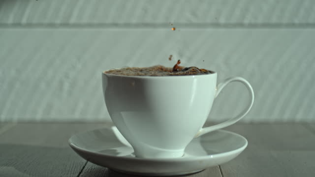 coffee pour slow motion cup creamer milk splash drop - jug stock videos & royalty-free footage