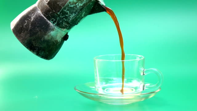 coffee pour slow motion on green screen - pouring stock videos & royalty-free footage