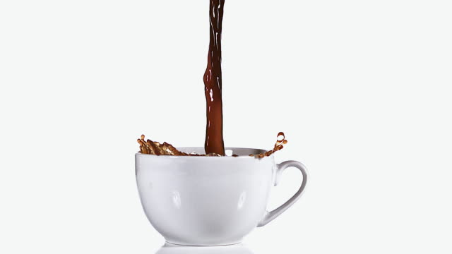 ms slo mo coffee pouring into bowl against white background / vieux pont, normandy, france  - coffee cup stock videos & royalty-free footage