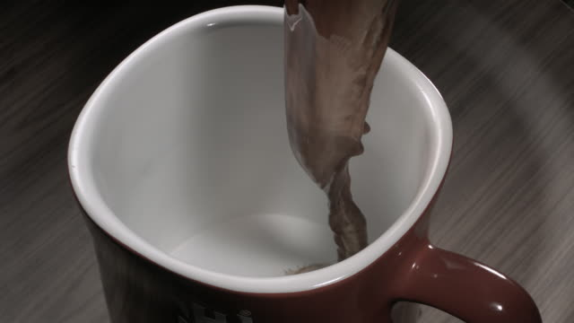 cu slo mo coffee pouring into mug - mug stock videos and b-roll footage