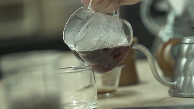 coffee preparation in slow motion - coffee drink stock videos & royalty-free footage